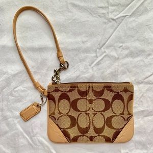New! COACH Brown and Tan wristlet. 5.5inX4in.